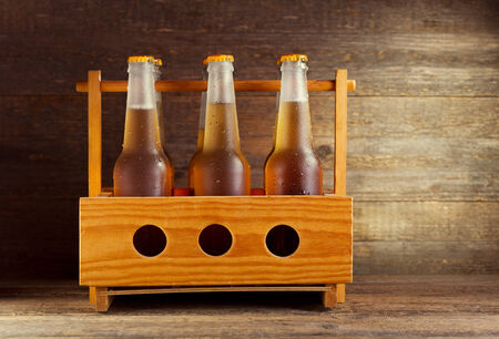 Wooden crate with beer bottles photo