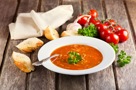 vegetable soup: plate of Minestrone Soup on wooden background