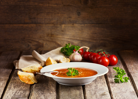 plate of Minestrone Soup on wooden background