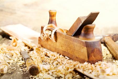 joiner: old wooden plane in a workshop