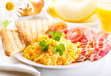 healthy breakfast with scrambled eggs, juice and fruits photo