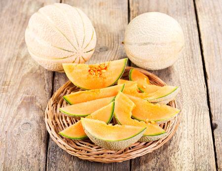 honeydew: fresh melon on wooden table