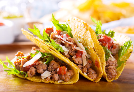 tacos: plate of tacos on wooden table Stock Photo