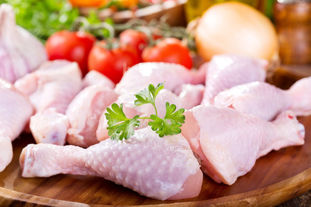raw chicken: raw chicken legs on wooden plate
