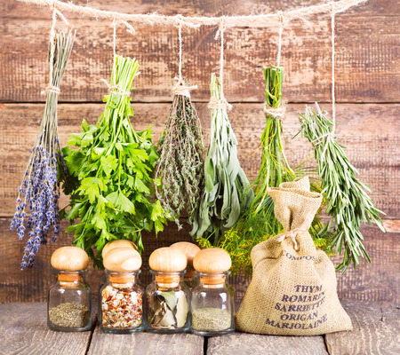 various fresh and dried herbs on wooden background Stock Photo