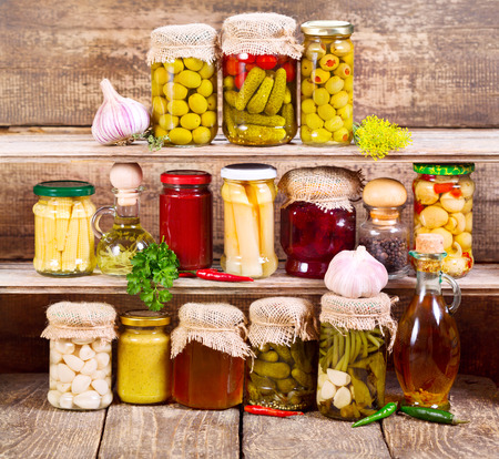 pickled: canned food on wooden background