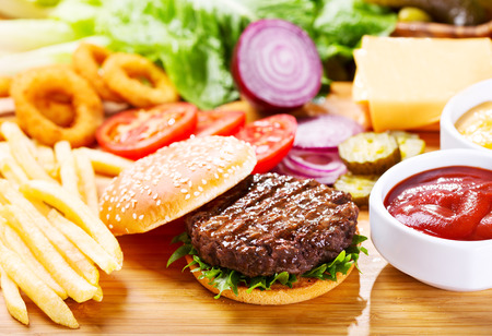 hamburger with fresh vegetables on wooden table