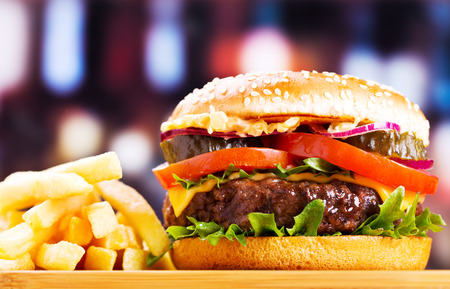 burger and fries: hamburger with fries on wooden table Stock Photo