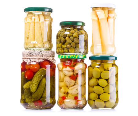 marinated gherkins: various preserved food isolated on white background