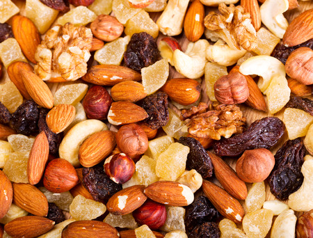 mixed dried nuts and fruit as background