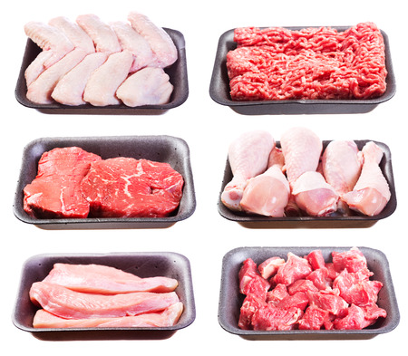 various: set of various raw meat in a plastic tray isolated on white background