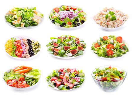 ensalada de frutas: conjunto de diversas ensaladas sobre fondo blanco