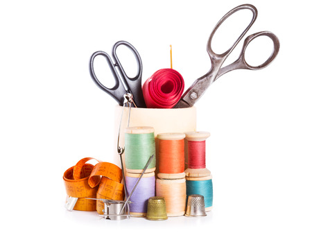 sewing item: scissors, various threads  and sewing tools on white background