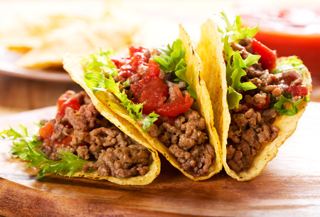 delicious food: plate of tacos on wooden table Stock Photo
