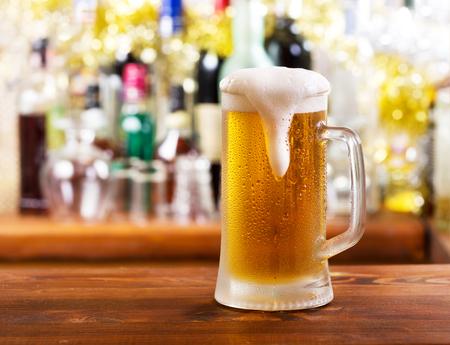 cold mug of beer in bar