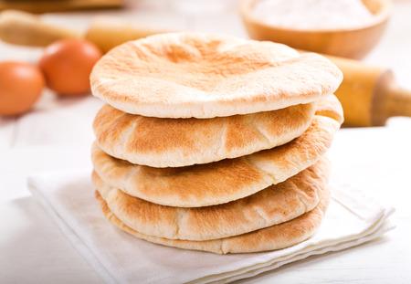 pita bread: pita bread on wooden board