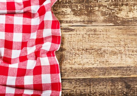picnic table: red tablecloth on old wooden table