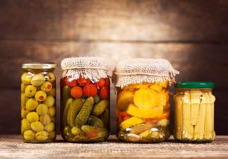 preserved: preserved vegetables on wooden background Stock Photo