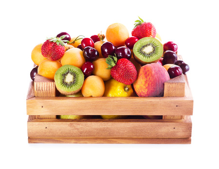 fresh various fruits in wooden box on white background