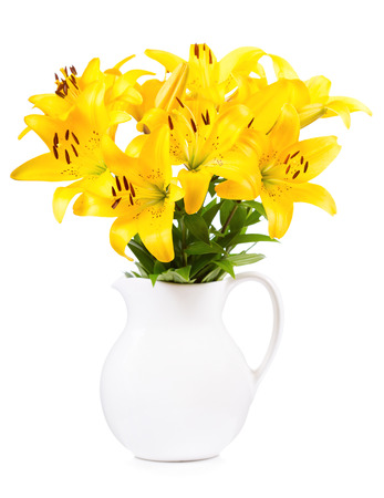 flor de lis: bouquet of yellow lilies in a jar on white background