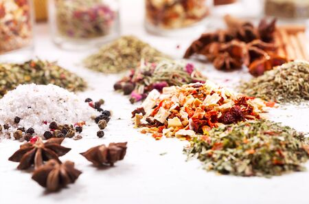 dried herbs: various dried herbs on old wooden table