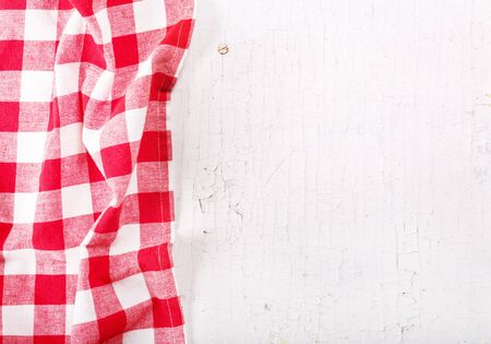 tablecloth: red tablecloth on old wooden table