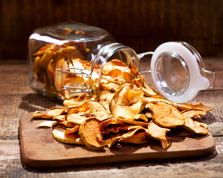 dried: dried apples on wooden table