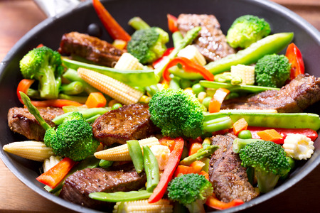 stir: meat with vegetable in a pan Stock Photo
