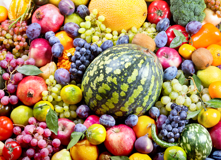 mixed vegetables: fresh fruits and vegetables as background