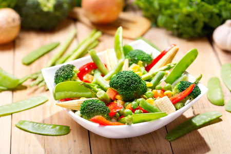 dish: mixed vegetables in a bowl on wooden table