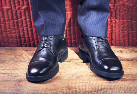 shiny suit: Close up of mans feet in a black shoes Stock Photo
