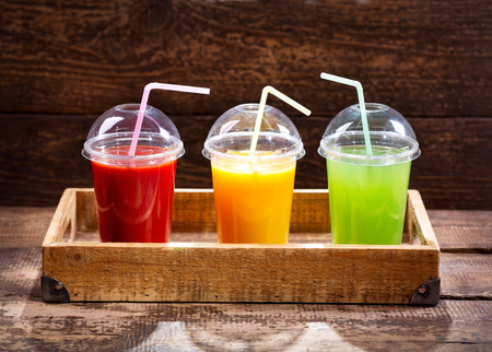 various fresh juices on wooden background 写真素材