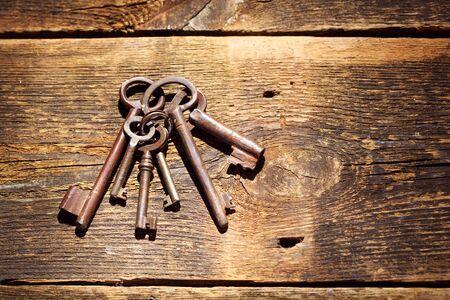 old keys: Old keys on wooden table