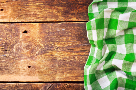 wooden table: green tablecloth on old wooden table