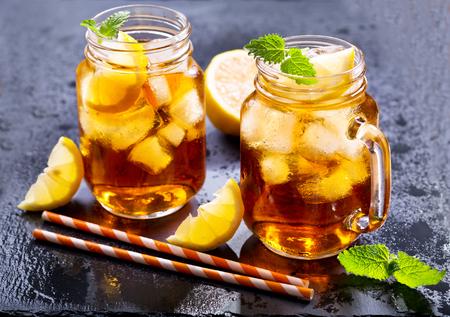 jar of lemon ice tea with striped straw Stock Photo