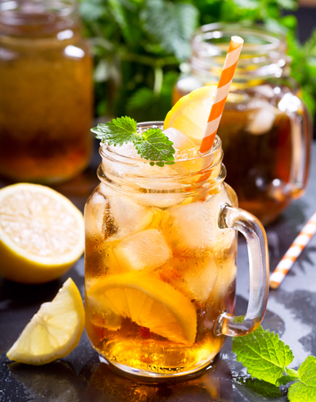 ice lemon tea: jar of lemon ice tea with striped straw Stock Photo