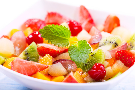 summer fruits: bowl of fruit salad with mint