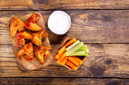 fried: fried chicken wings on wooden board