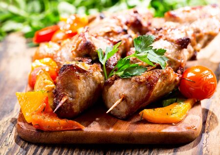 lunch meal: grilled meat with vegetables on wooden board