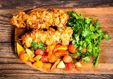 grilled vegetables: grilled chicken with vegetables on wooden board Stock Photo