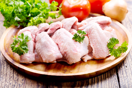 of raw: raw chicken wings with parsley Stock Photo