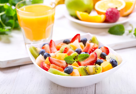 bowl of fruit salad on wooden table