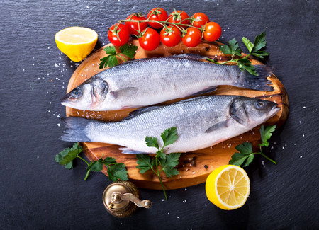 sea bass: fresh fish sea bass on wooden board