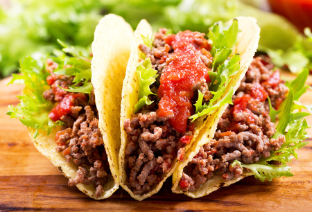 salsa: mexican tacos with meat and salsa on a wooden table