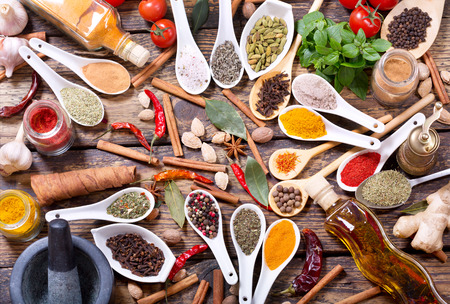 molinillo: various herbs, spices and vegetables for cooking on wooden table, top view