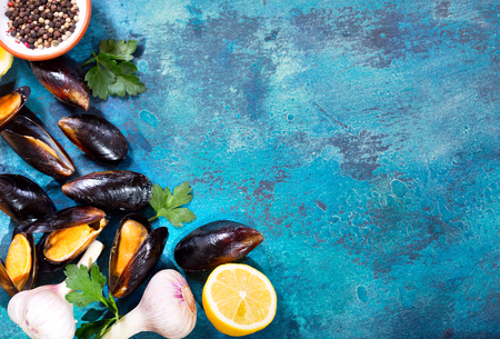 mussels with parsley and lemon on old blue background, top view 写真素材