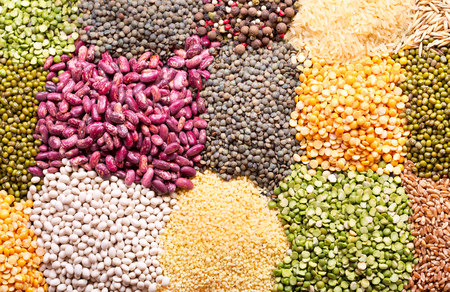 assortment: various cereals, seeds, beans and grains as background