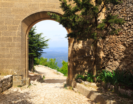 arches: view through old stone entrance to the valley