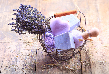 spa flower: basket of  lavender spa products on wooden table Stock Photo