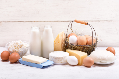 various dairy products on wooden table
